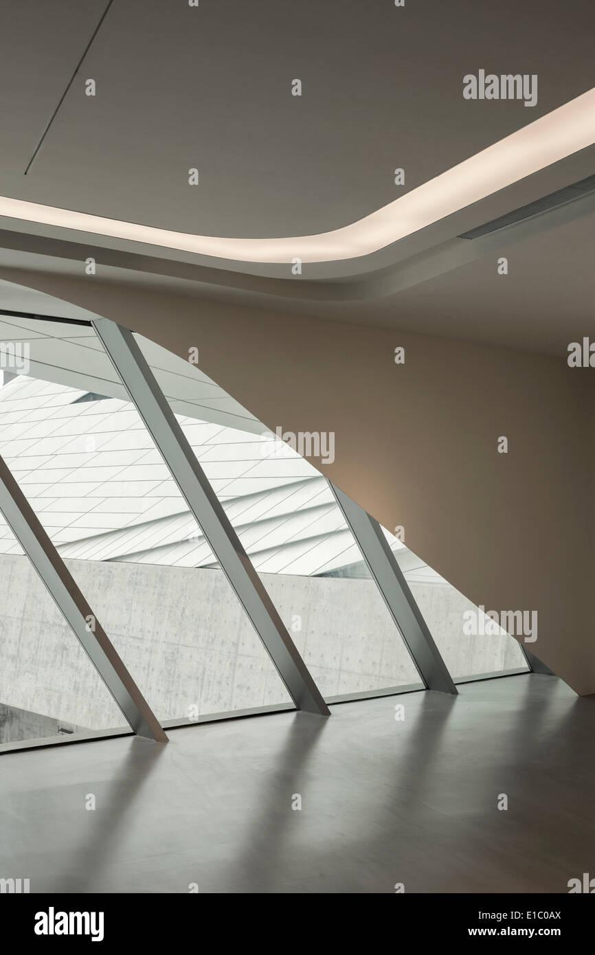 Jockey Club Innovation Tower, Hong Kong, China. Architect: Zaha Hadid Architects, 2014. View of north entrance lobby. Stock Photo