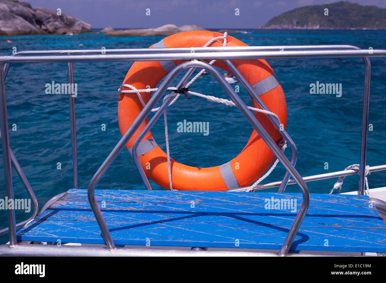 orange life saver on speedboat - Stock Image