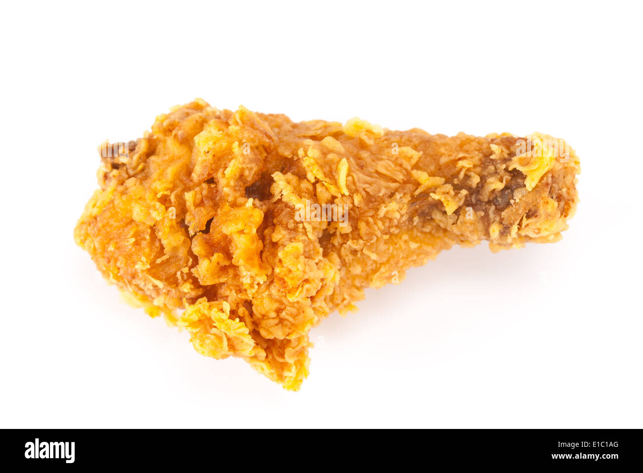 Fried chicken on dish on white background - Stock Image