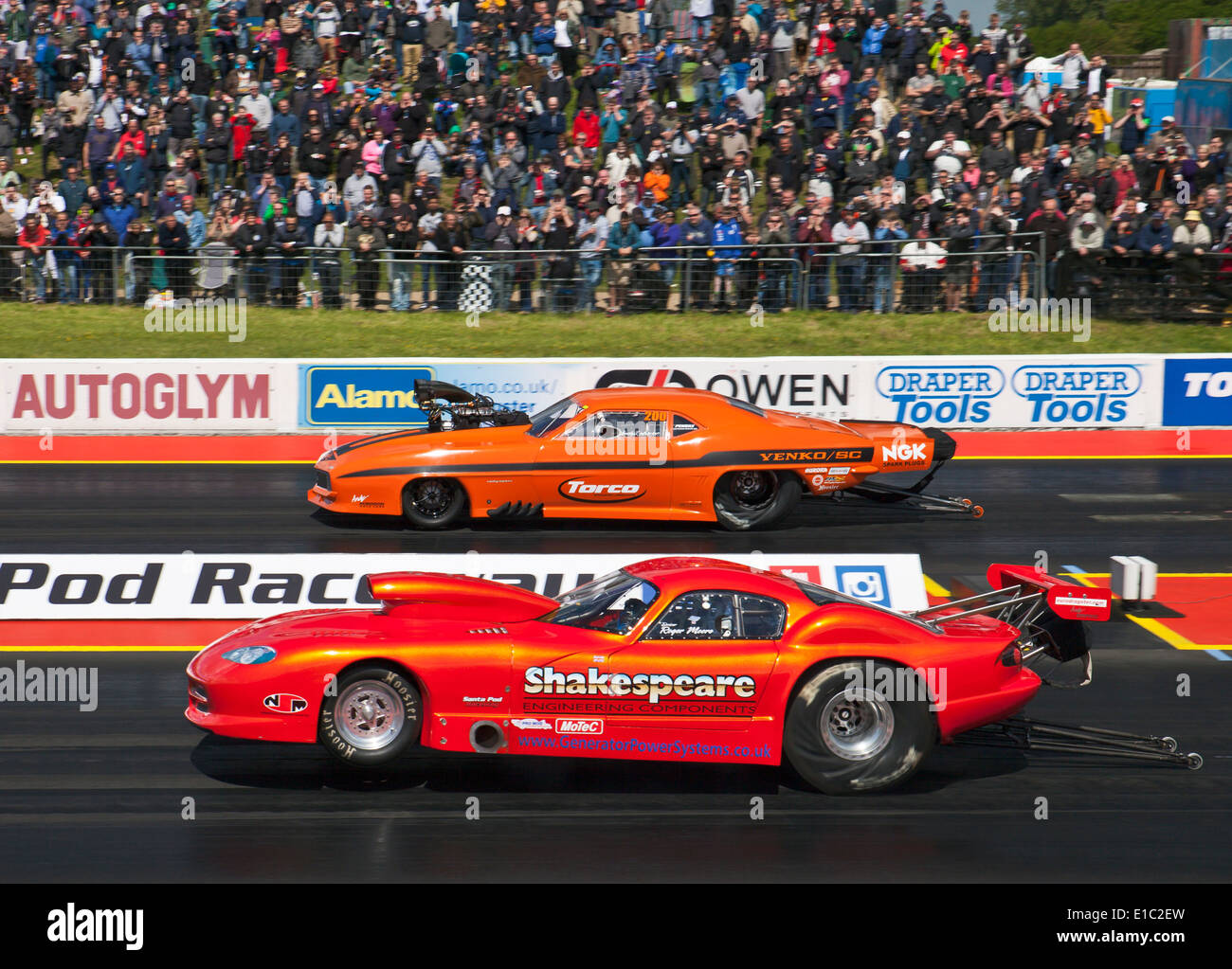 Pro Mod cars drag racing at Santa Pod. Roger Moore nearside Andy Robinson far side. - Stock Image
