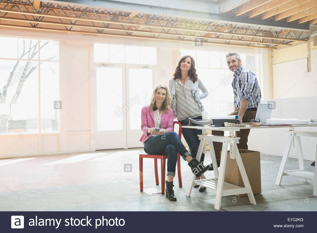 Portrait of confident business people in new office - Stock Image