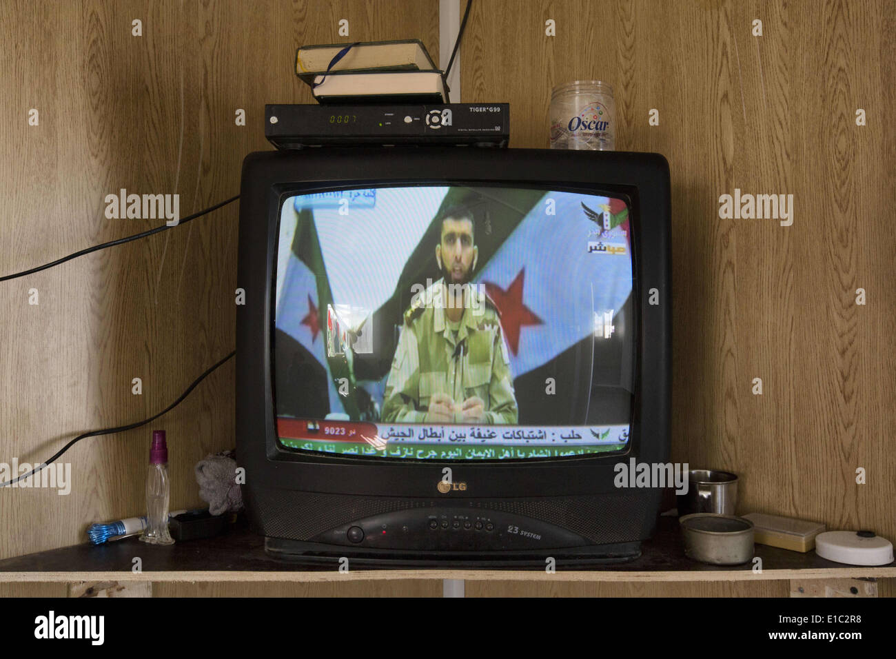 Al Mafraq, JORDAN. 8th Feb, 2014. For those fortunate enough to have satellite capabilities, Free Syrian Army television - Stock Image