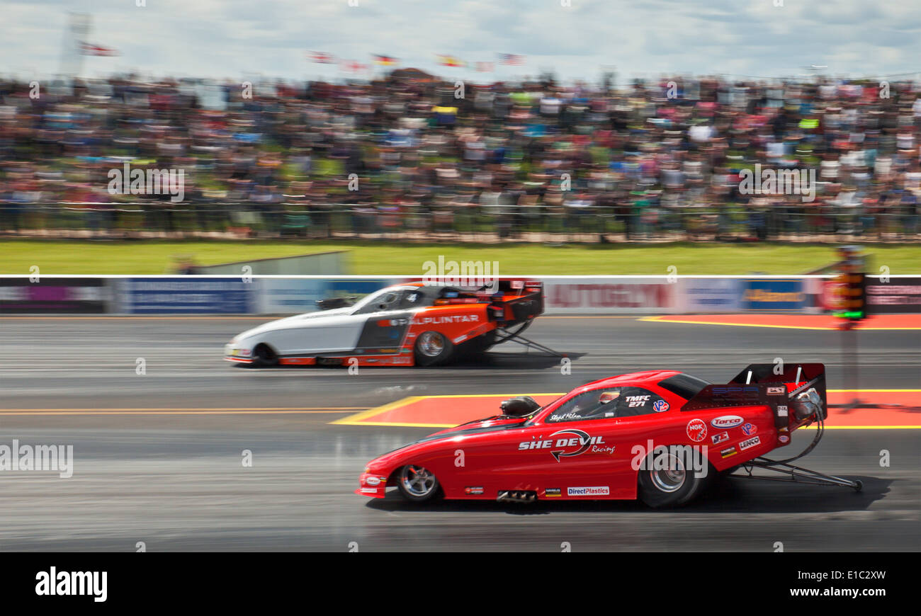 Top Methanol funny cars drag racing at Santa Pod. Stephanie Milam ...