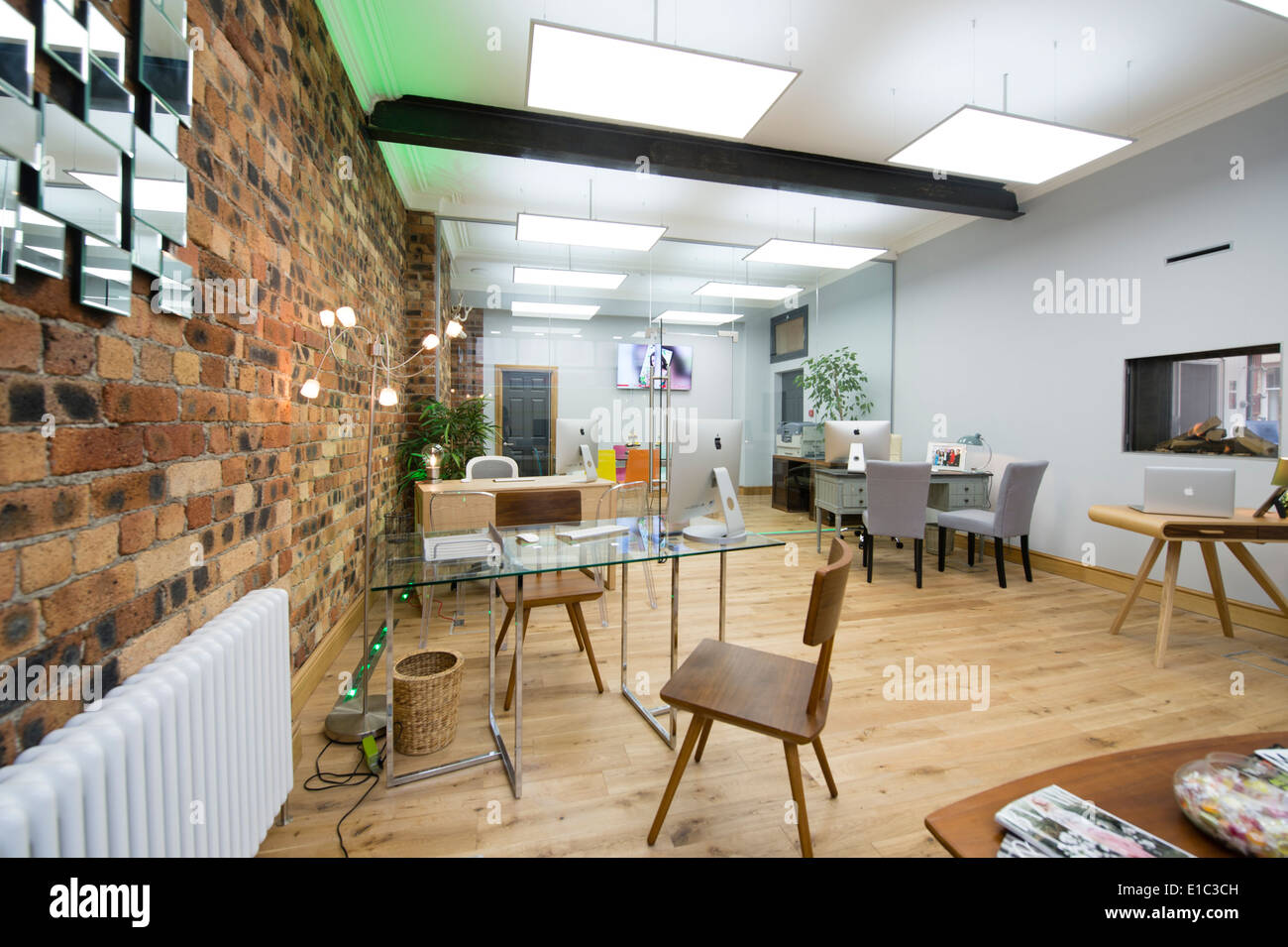 a modern clean light airy open plan estate agent s office interior
