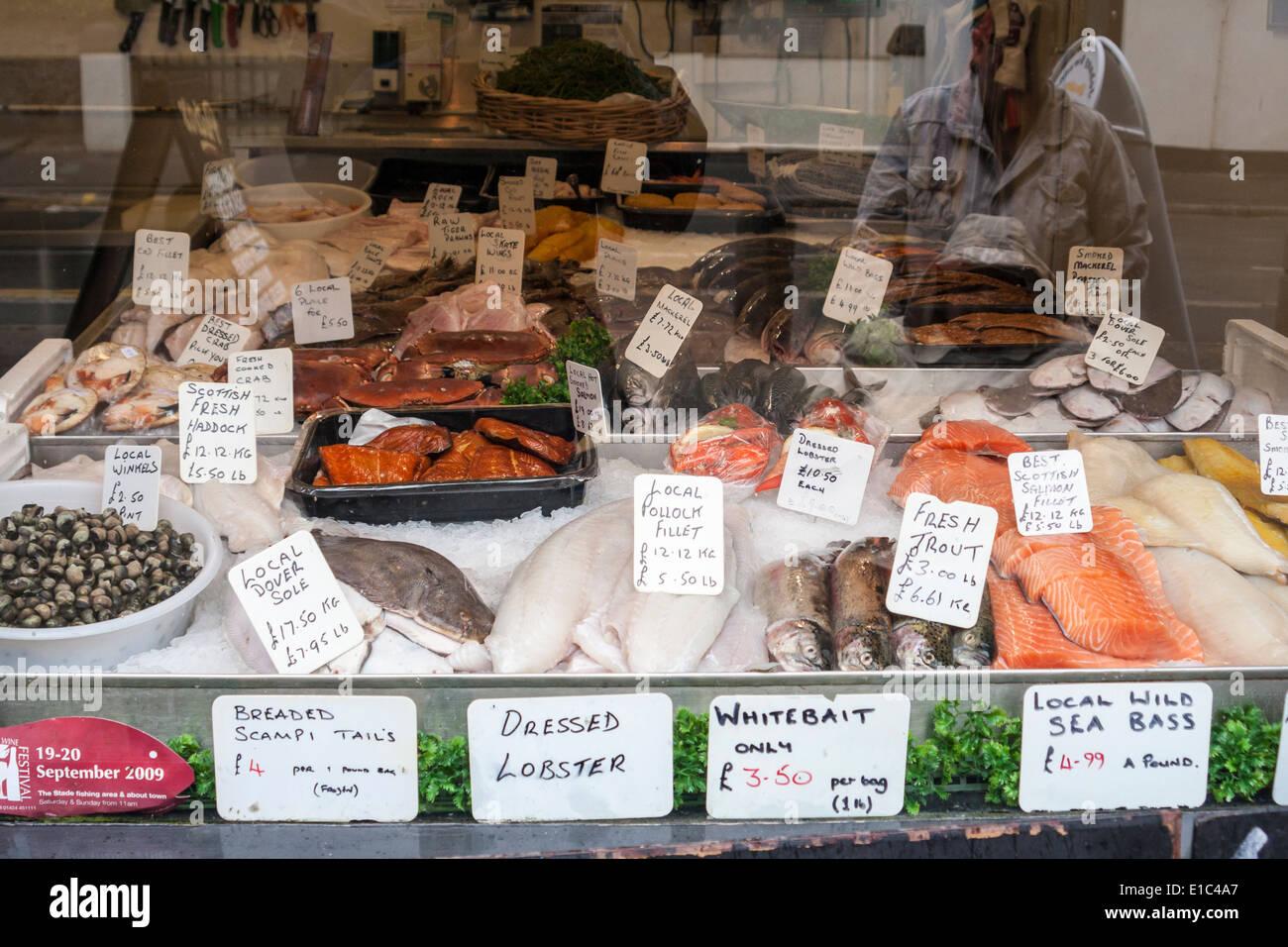 Local fresh fish fishmonger's shop window display, Hastings, Sussex, England, GB, UK - Stock Image