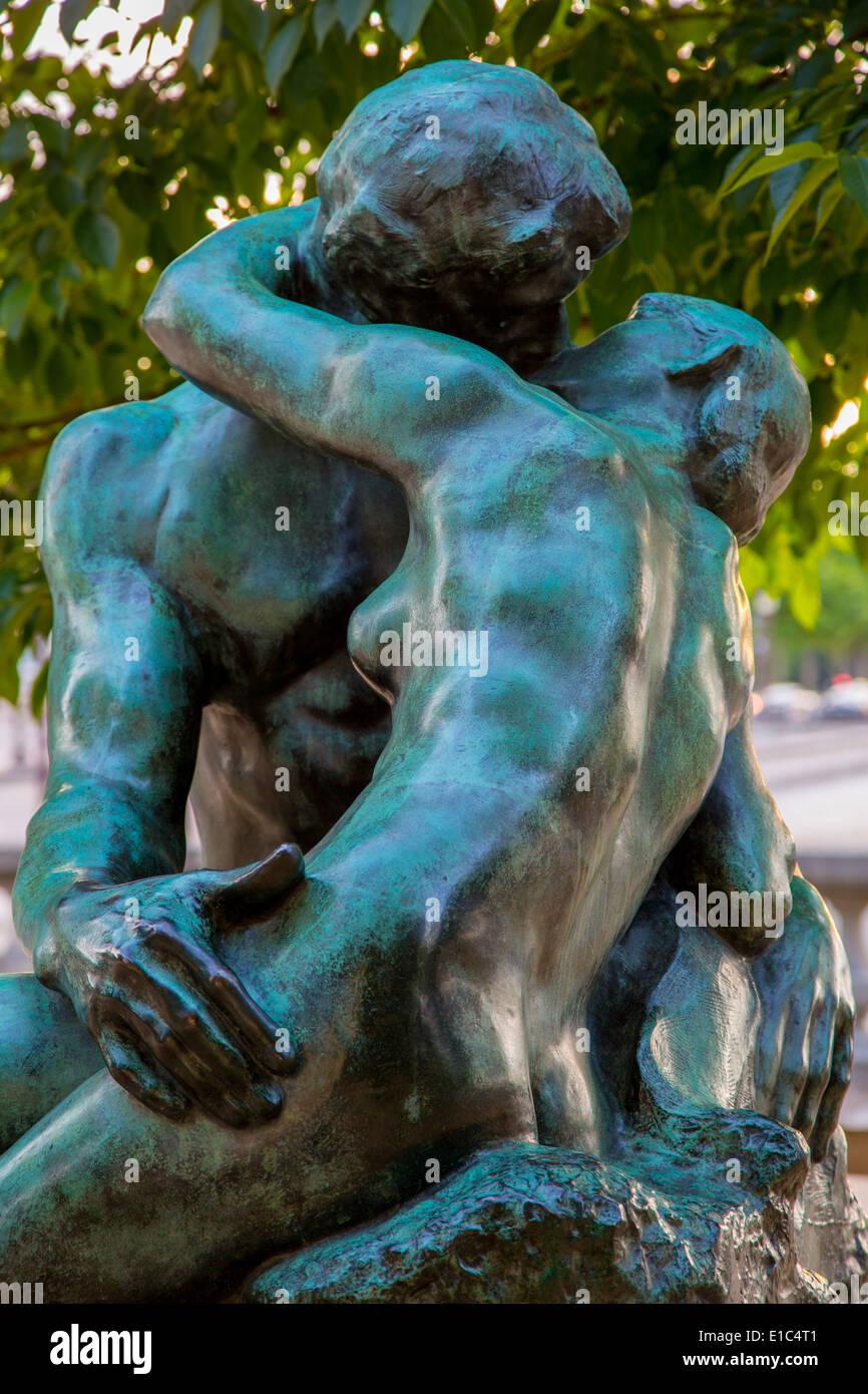 Bronze copy of Auguste Rodin's 'Le Brasier' (The Kiss), near the garden entrance to L'Orangerie Museum, Paris France Stock Photo