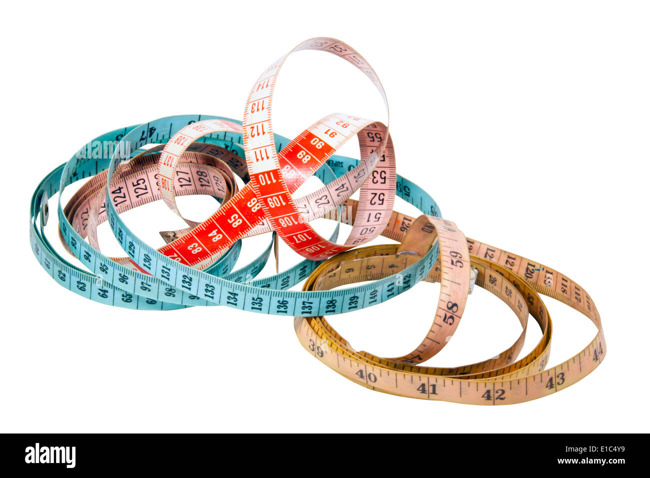 three tape measures marked in inches and centimeters Stock Photo