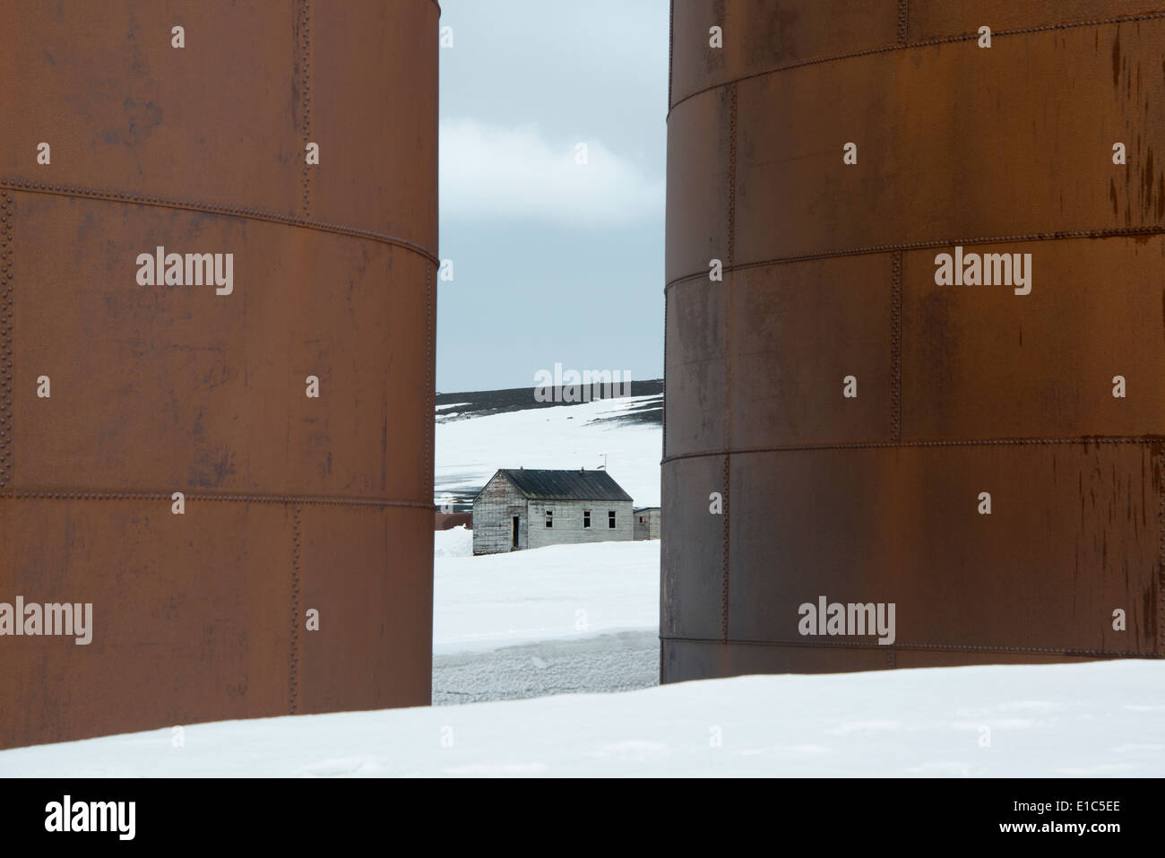 The tall sides of rusting metal whale oil tanks at the former whaling station on Deception Island. - Stock Image