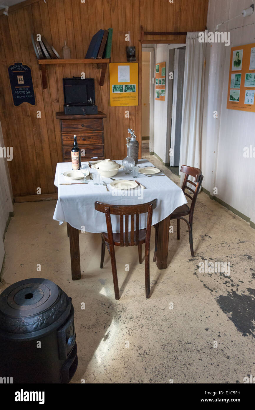 Scientific research station at Camp Livingston. A dining table and chairs with place settings. - Stock Image