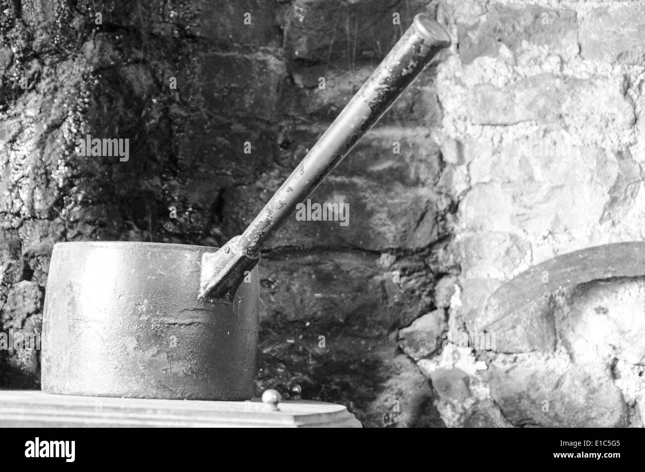 Old household items decorating an inn - Stock Image