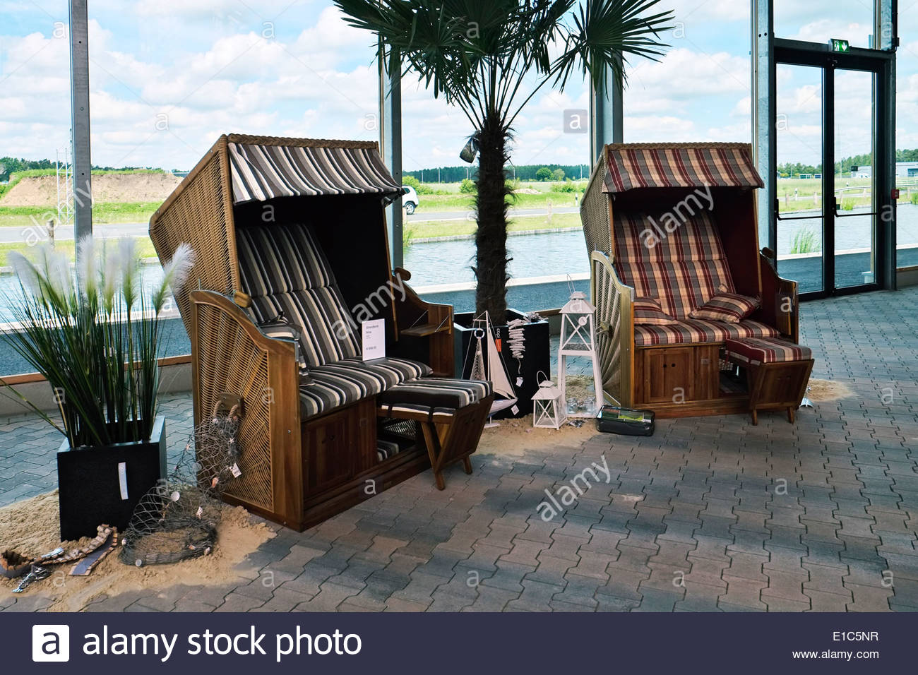 Strandkörbe — beach chairs — are displayed for sale at a garden store showroom in Germany. - Stock Image