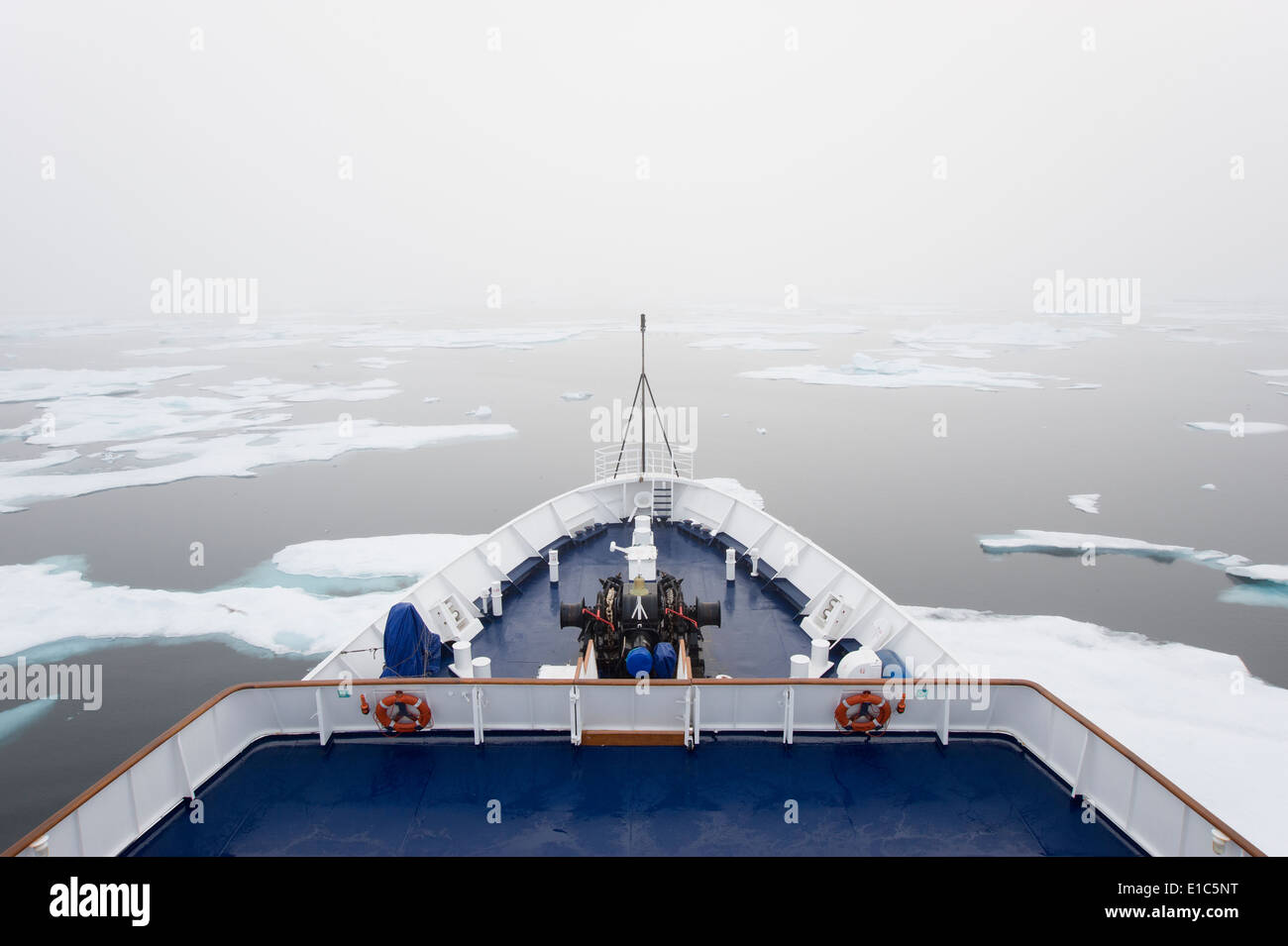 The view over the decks of a cruise ship in the Canadian Arctic region, moving through ice floes. - Stock Image