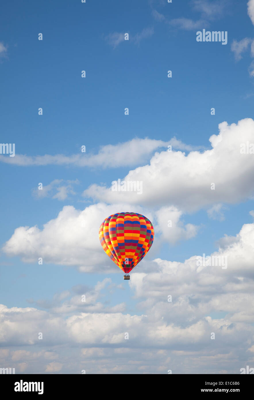 Hot air balloon against blue sky - Stock Image