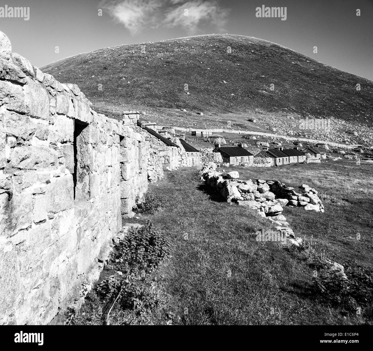 A view of Main Street, Village Bay, St. Kilda, showing both the ancient and newer blackhouses - Stock Image