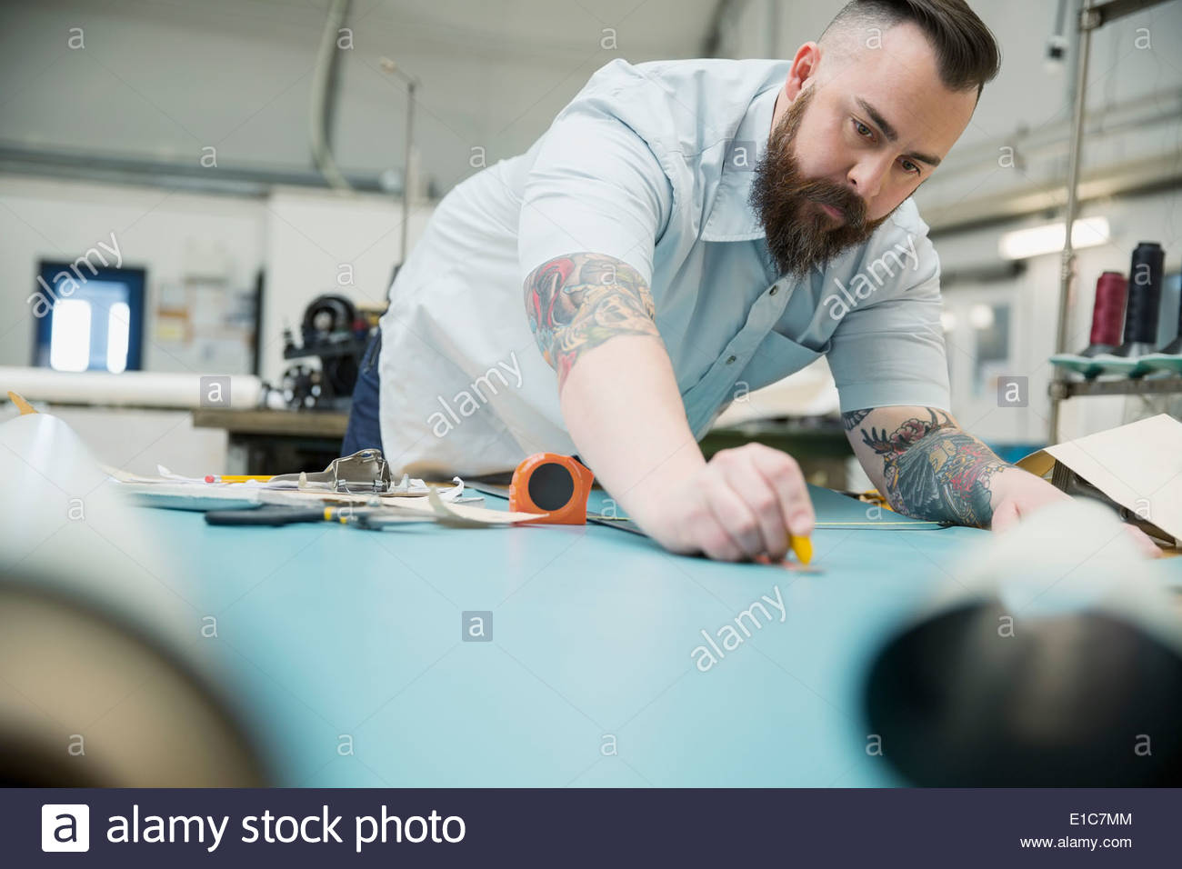 Worker in textile manufacturing plant Stock Photo