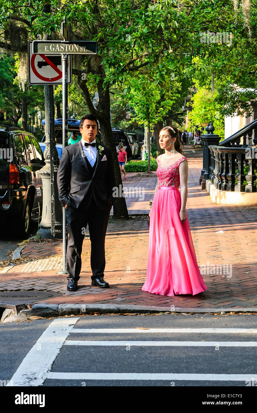 High school prom night with teen boys and girls walking through the streets of Savannah GA - Stock Image
