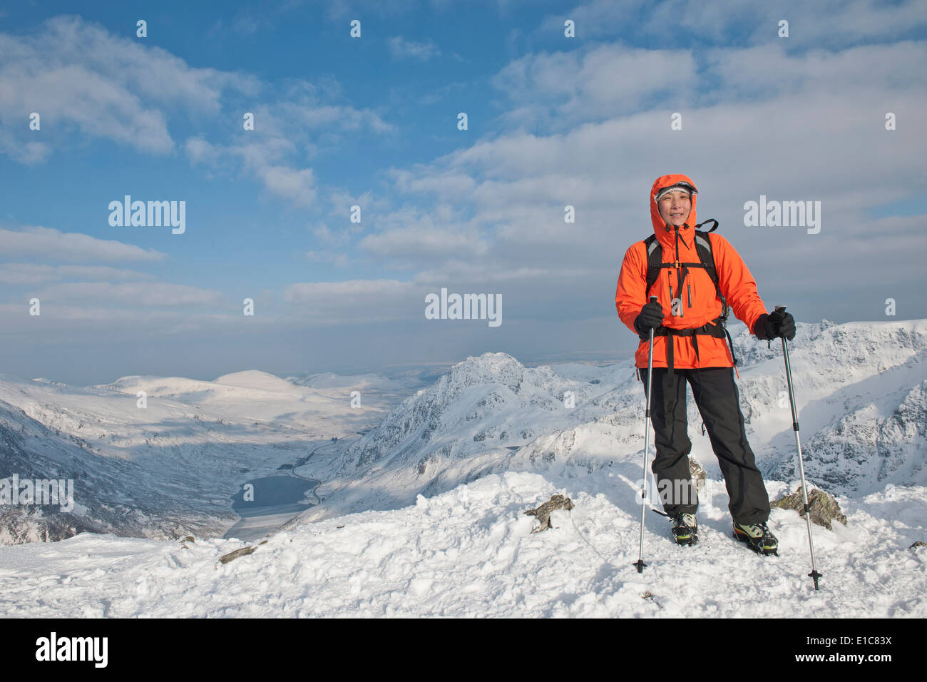 Female hiker on top of a snowcovered peak in north Wales - Stock Image