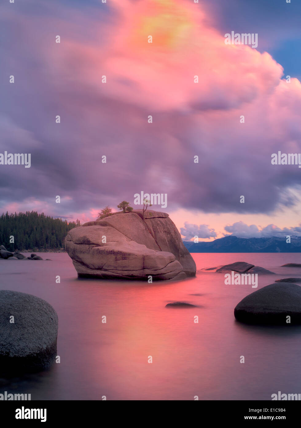 Sunset clouds and granite boulders on east side of Lake Tahoe, Nevada - Stock Image