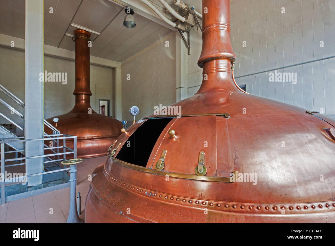 Copper brew kettles at Brouwerij Lindemans, Belgian brewery at Vlezenbeek, producer of geuze and kriek beer - Stock Image