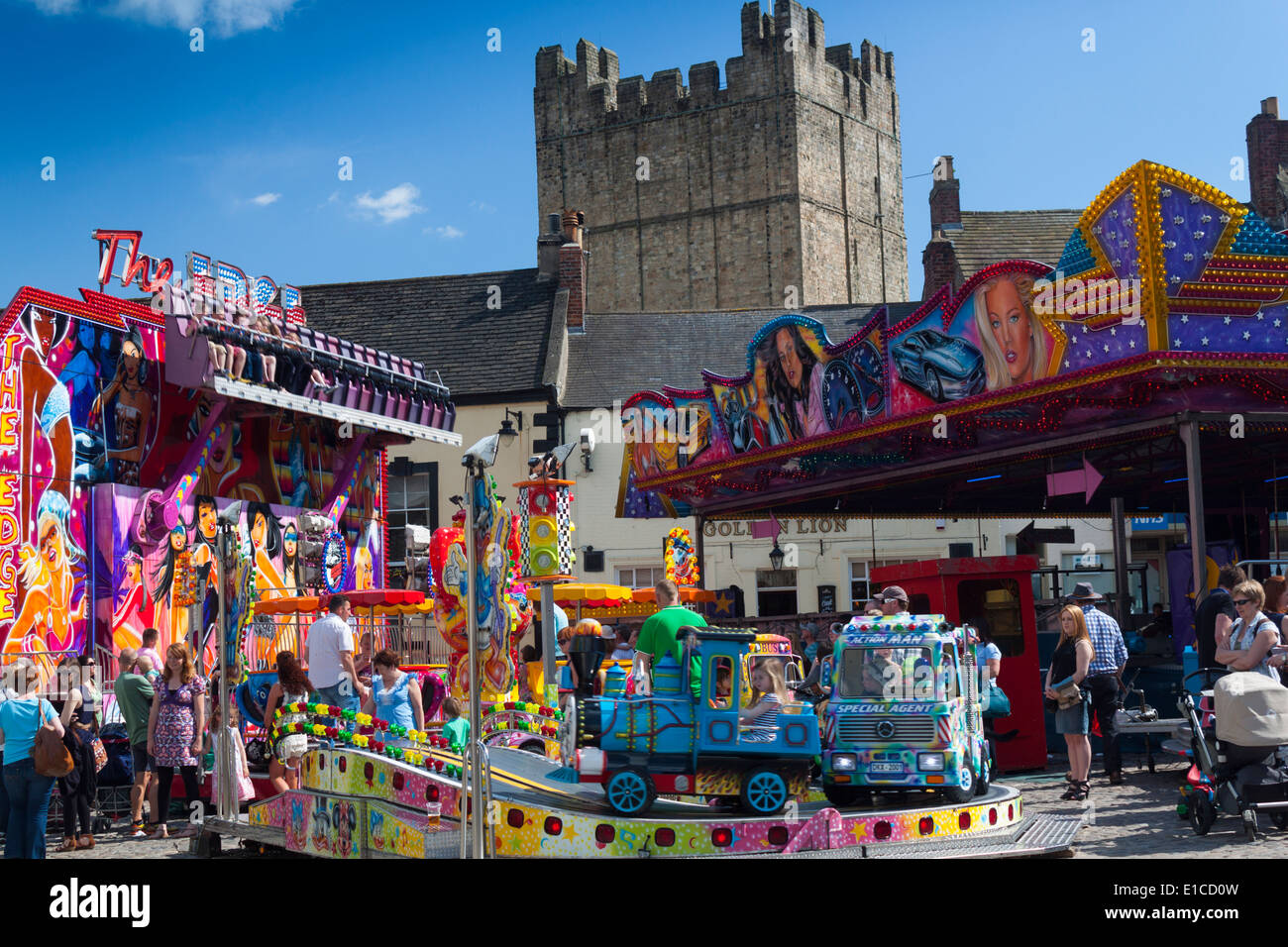 Whit fair In Richmond Market Place North Yorkshire with view of Castle Keep. - Stock Image