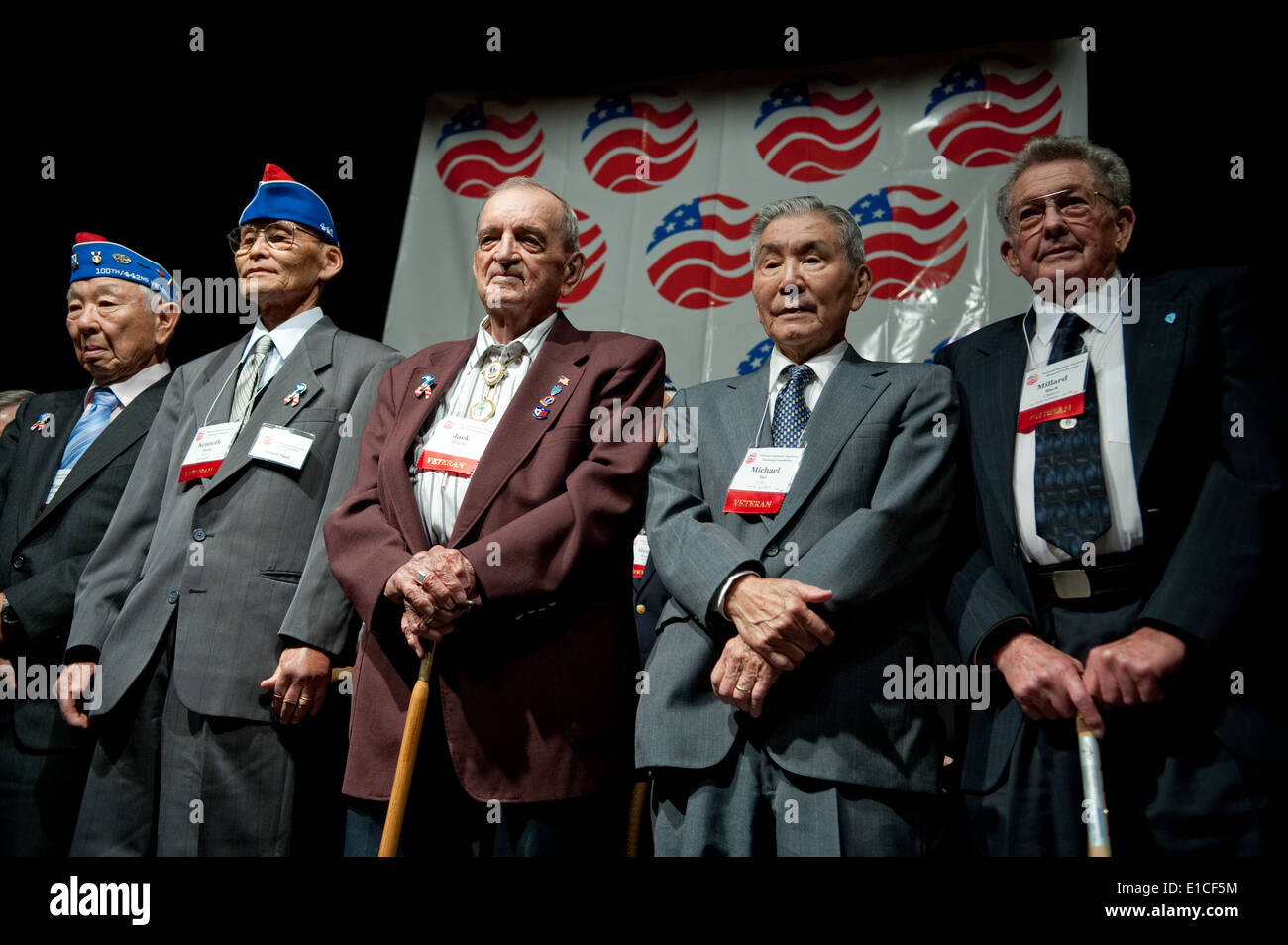 US Army Veterans From The 141st Infantry Regiment And 442nd Regimental Combat Team Stand During