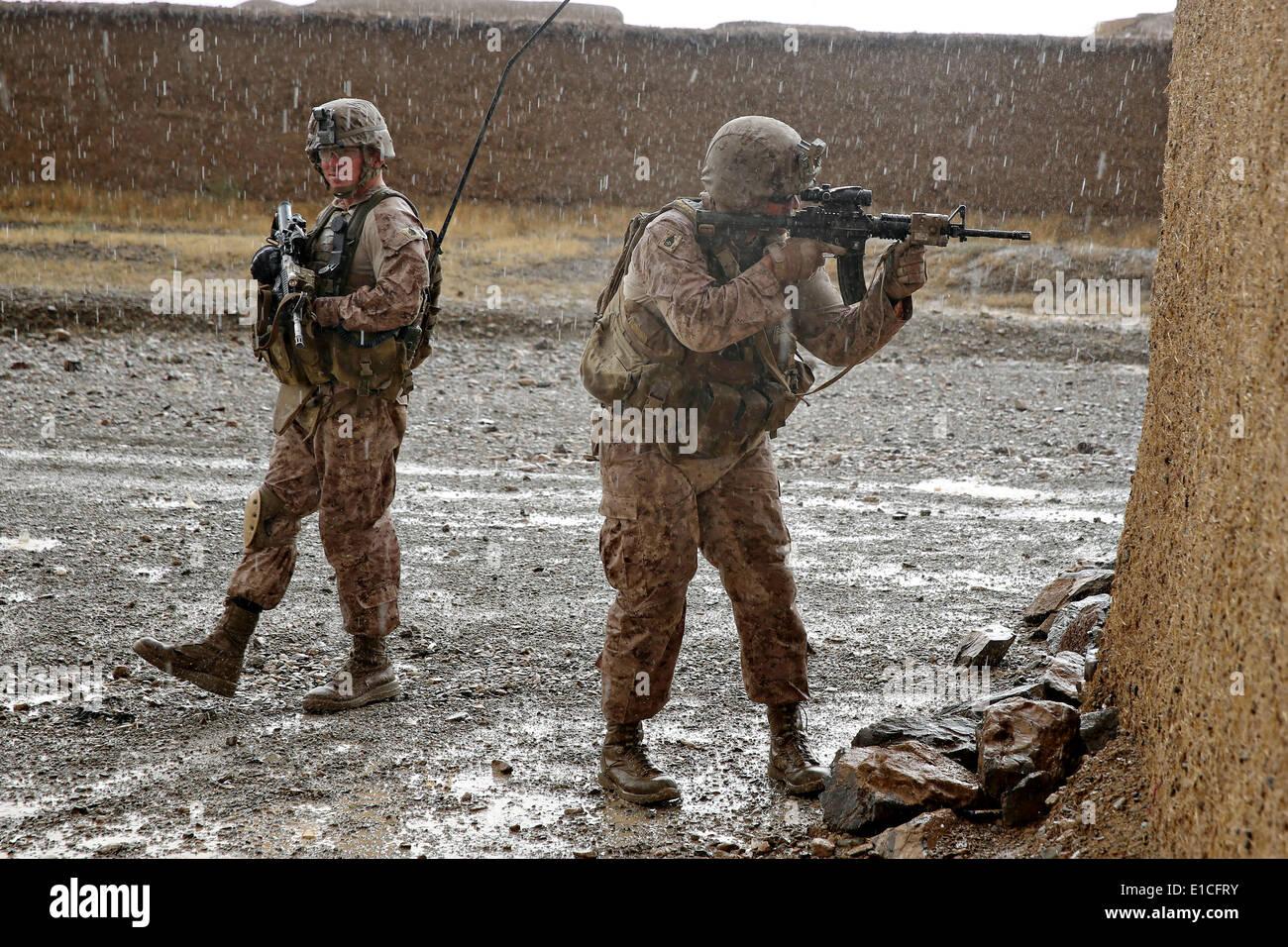 US Marines with the 1st Battalion, 7th Marine Regiment, patrol ...