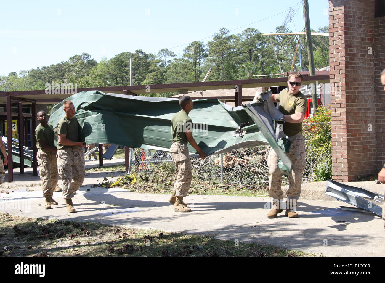 U.S. Marines remove tornado-damaged metal roofing April 18, 2011, from the Tarawa Terrace housing area at Marine Corps Base Cam - Stock Image