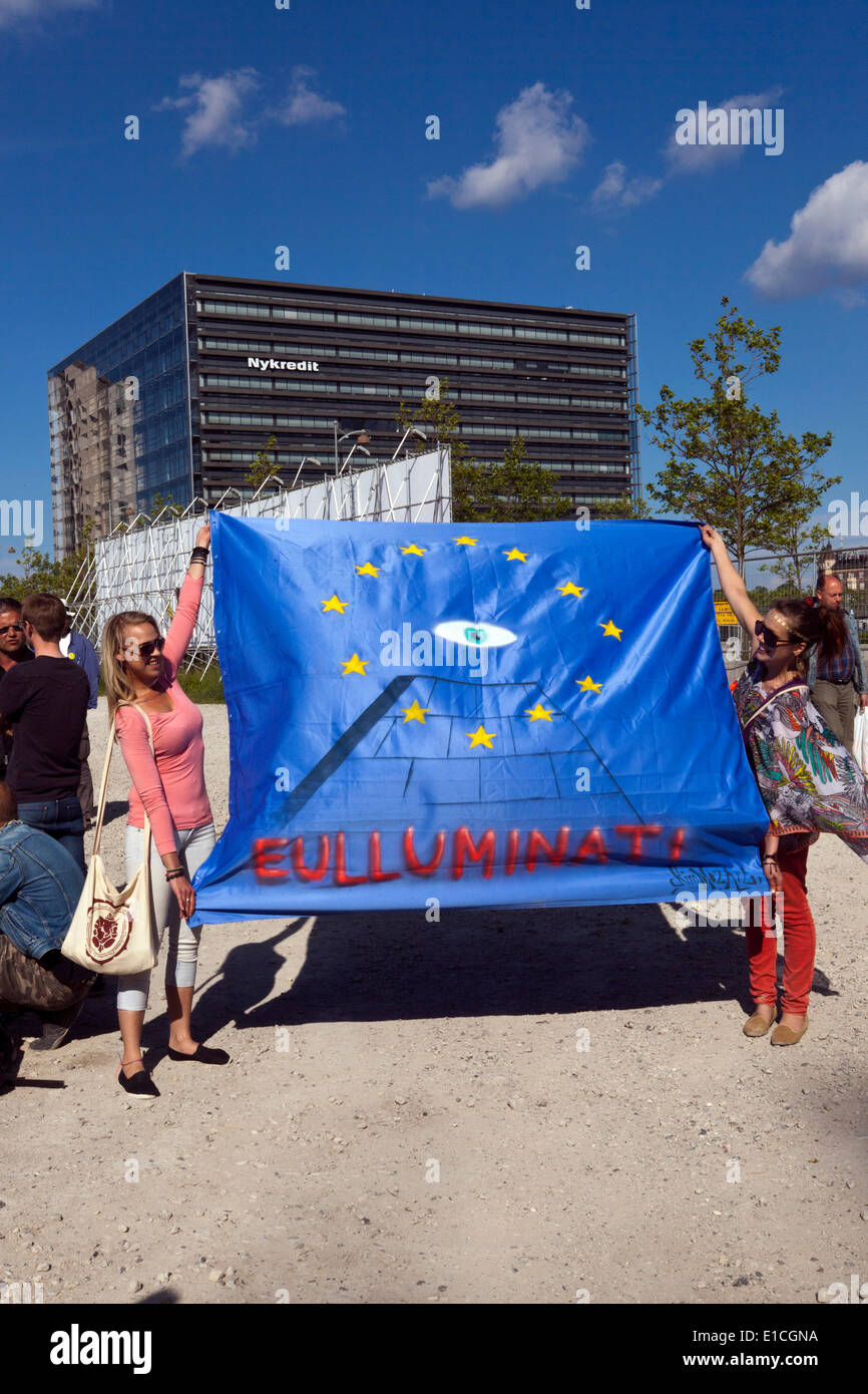 Copenhagen, Denmark. 30th May 2014. Two young women shows their poster, which is meant as a protest against the Bilderberg group, which holds their 62nd meeting in at the Copenhagen Marriott from May29th to June 1st  . Credit:  OJPHOTOS/Alamy Live News - Stock Image