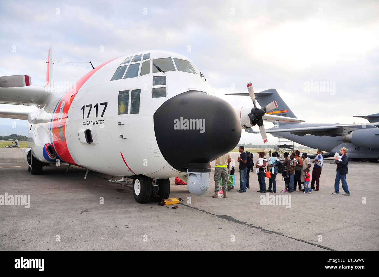A U.S. Coast Guard C-130 aircraft from Coast Guard Air Station Clearwater, Fla., takes on Haitian American passengers Stock Photo