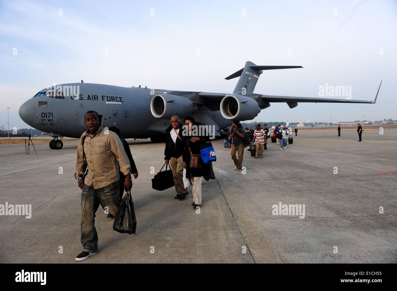 U.S. citizens evacuated from Haiti disembark a U.S. Air Force C-17 Globemaster III aircraft at the Charleston International Air - Stock Image
