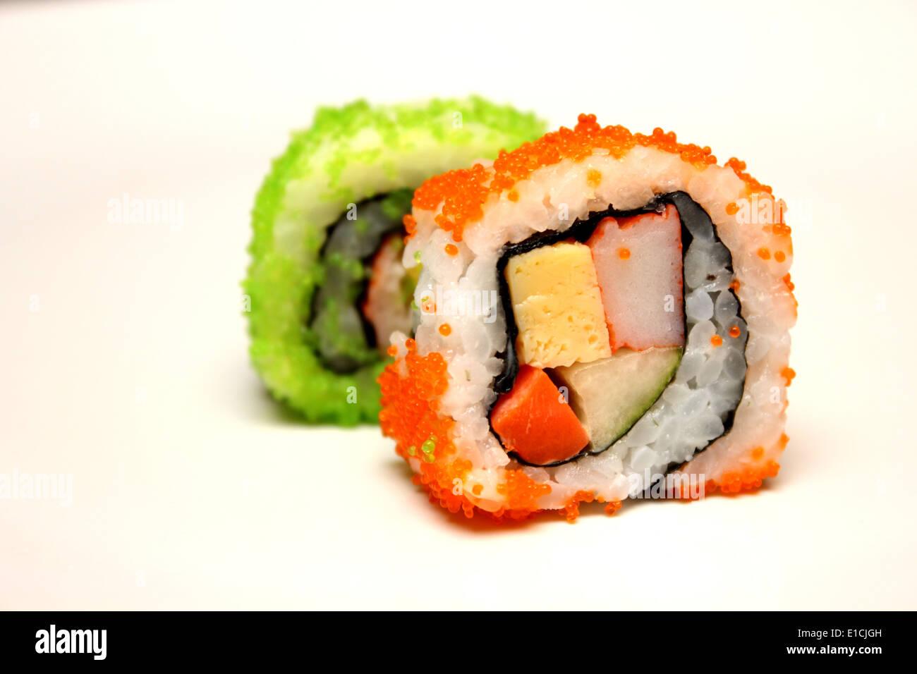Closeup detail of nigiri sushi and california rolls. - Stock Image