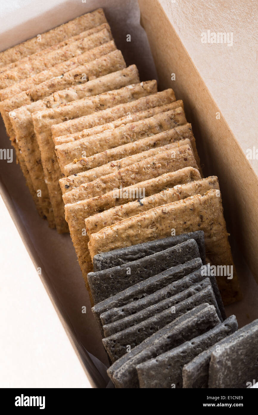 Wholemeal and charcoal crackers - Stock Image