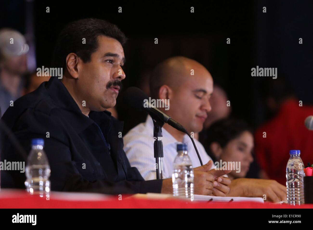 Caracas, Venezuela. 30th May, 2014. Venezuela's President, Nicolas Maduro (L), attends an national encounter of missionaires, at Venezuela's Military Academy Theater, in Caracas, Venezuela, on May 30, 2014. During the encounter, Maduro assured that through the govern programs known as 'Social Missions', the bureaucracy scheme and the bourgeois state are broken. © Presidential Press/AVN/Xinhua/Alamy Live News - Stock Image