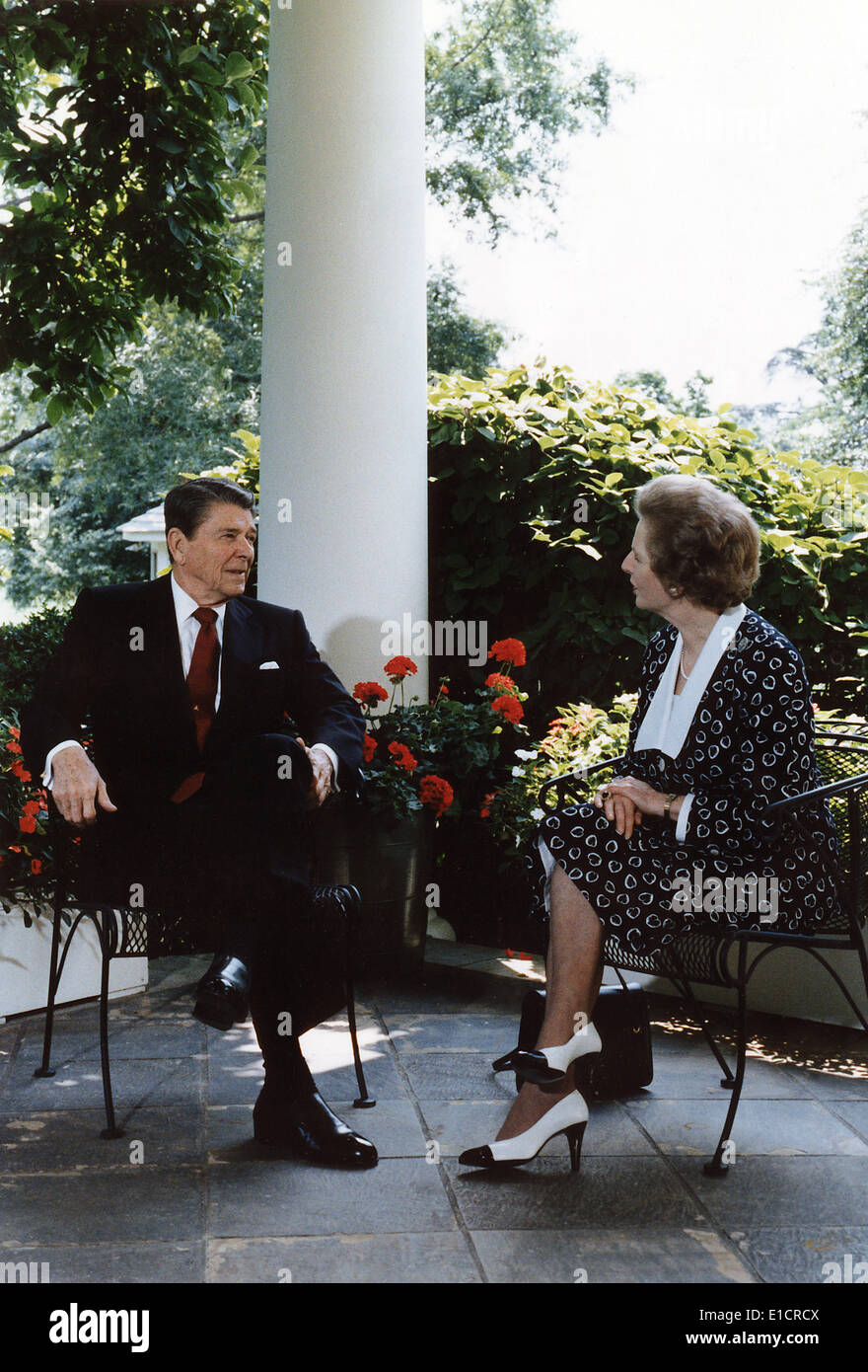 Ronald Reagan. President Reagan and Prime Minister Thatcher talking on the patio outside of the Oval Office. The - Stock Image
