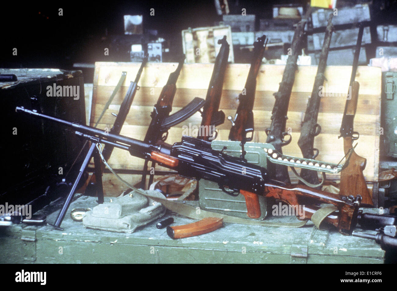 A Soviet-made 7.62mm PKM light machine gun and other weapons seized in Operation Urgent Fury during the invasion of Grenada. - Stock Image