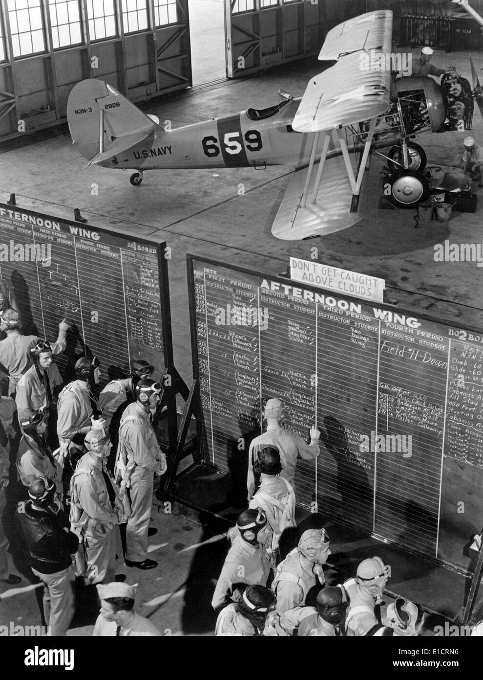 Aviation cadets check flight boards for last minute instructions at Corpus Christi, Texas. World War 2, Nov. 1942. - Stock Image