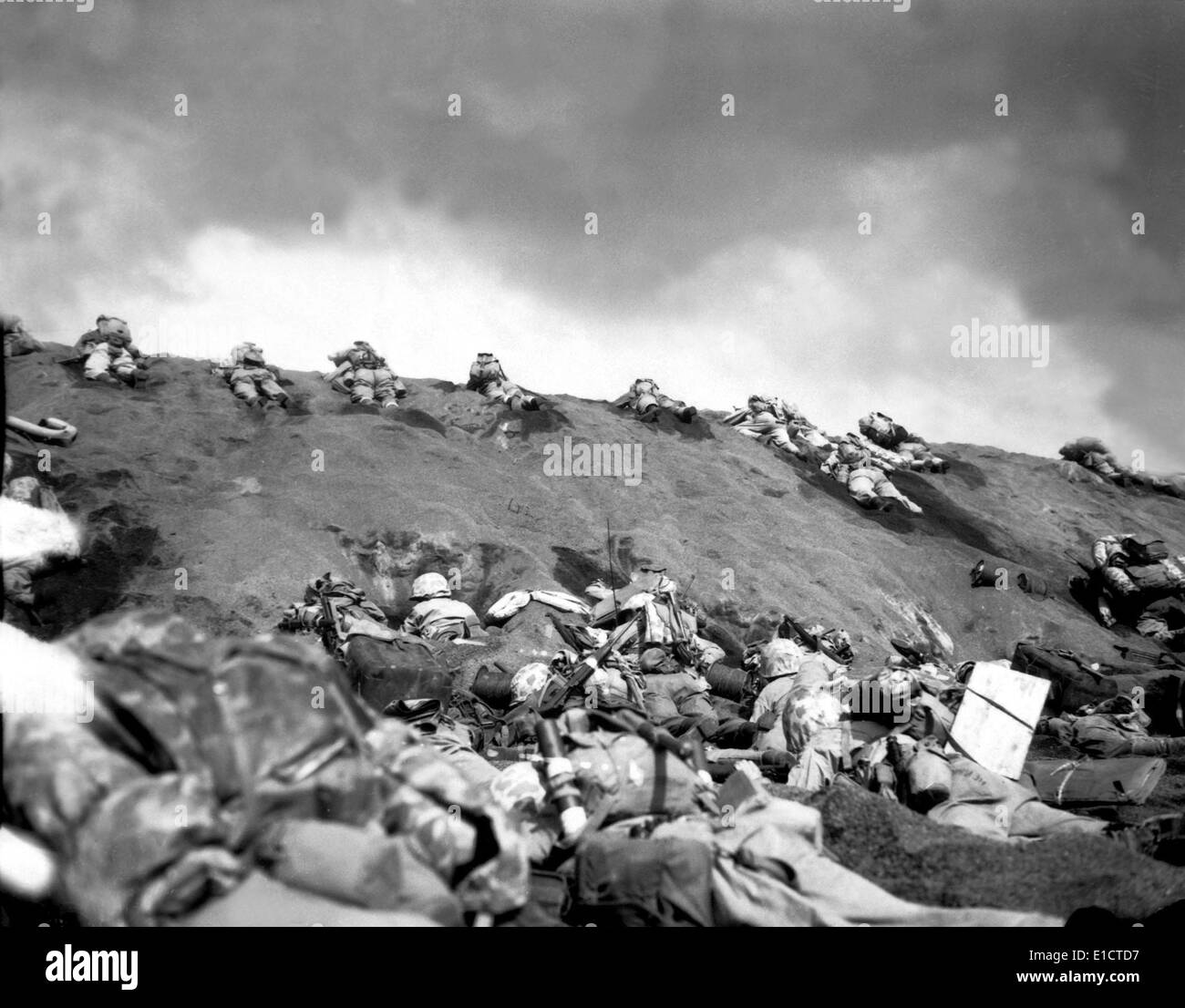 5th Division Marines crawl up a slope on Red Beach No. 1 toward Mt. Suribachi on Iwo Jima. Feb. 19, 1945. World Stock Photo