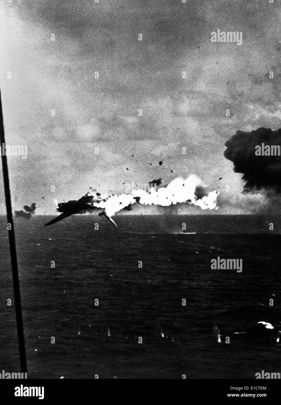 Japanese bomber explodes after direct hit by 5 inch shell from USS Yorktown, Dec. 4, 1943. Off Kwajalein Atoll. World War 2, - Stock Image