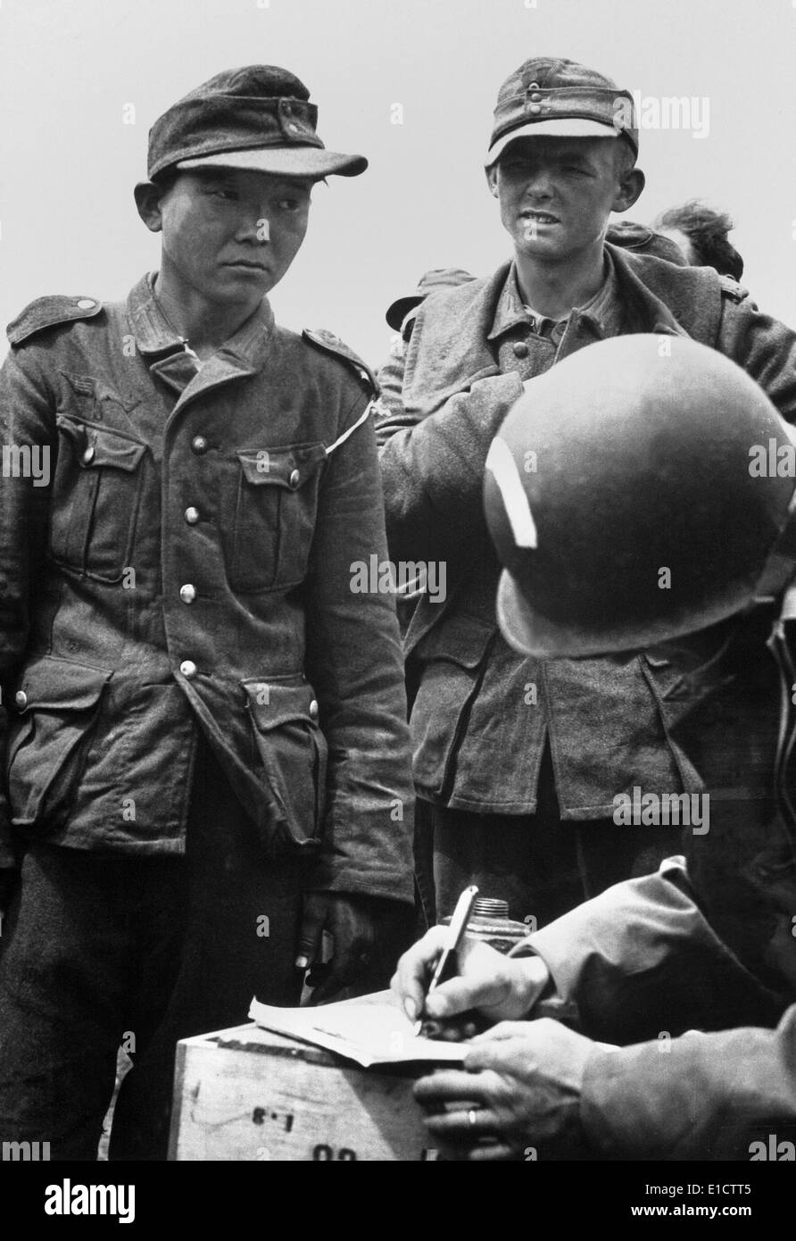 Japanese youth, wearing a Nazi uniform, was among German prisoners captured on the beaches of France. American Army Stock Photo