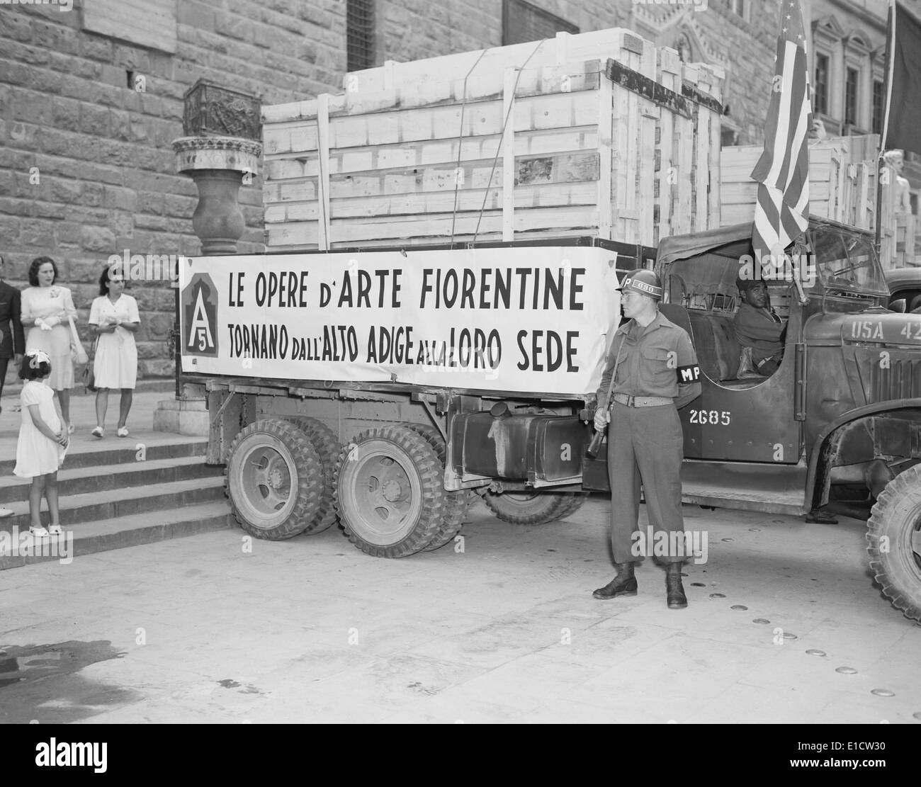 U.S. Soldier guards a truck holding stolen Italian artworks during World War 2. The crated paintings were stolen Stock Photo