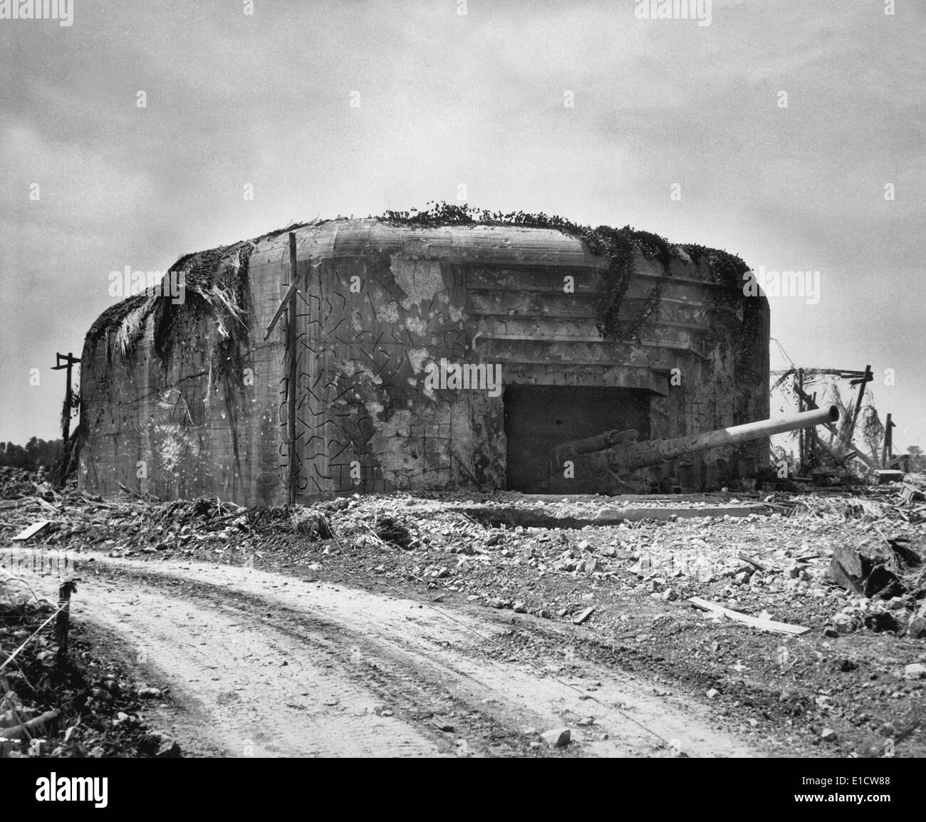 German gun emplacement had concrete walls 13 feet thick and four 10 1/4 inch guns. This position was taken out of action by - Stock Image