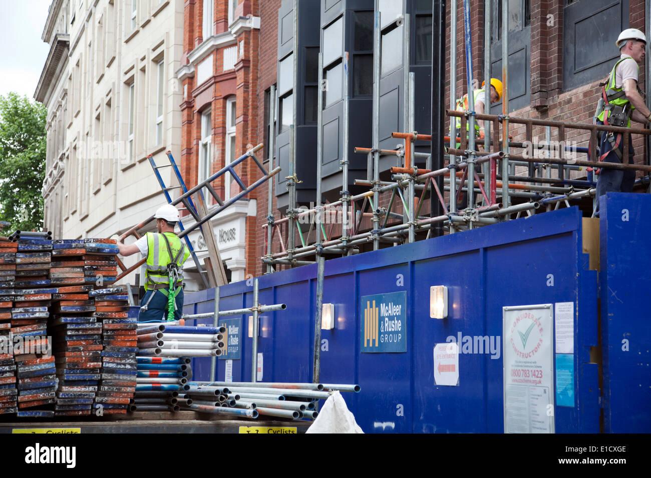 Scaffolders in Central London - St Martins Lane - UK - Stock Image