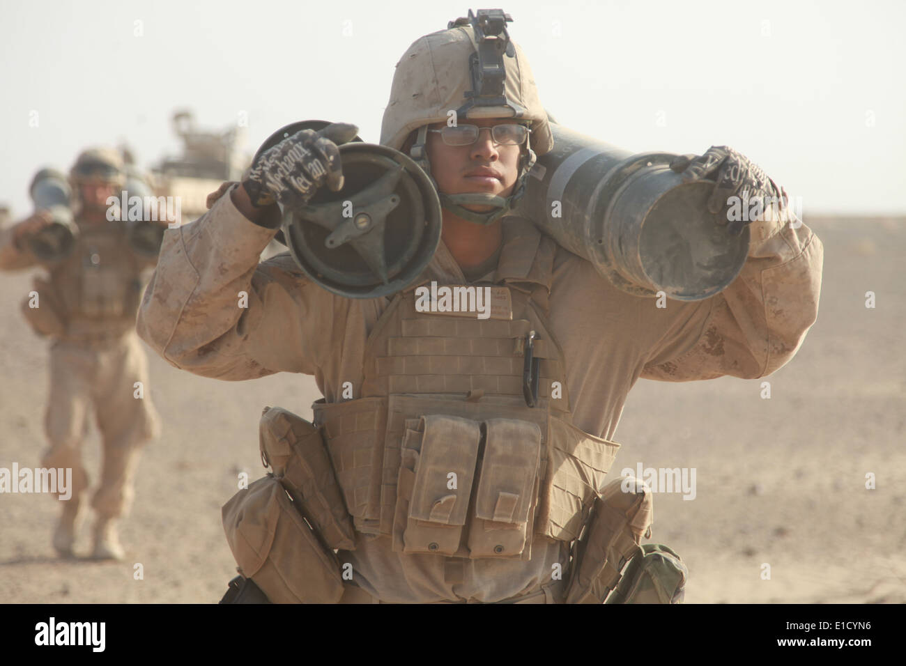 U.S. Marine Corps Lance Cpl. Juan Acosta carries powder charges in the Helmand province of Afghanistan Oct. 28, 2009. Acosta is - Stock Image