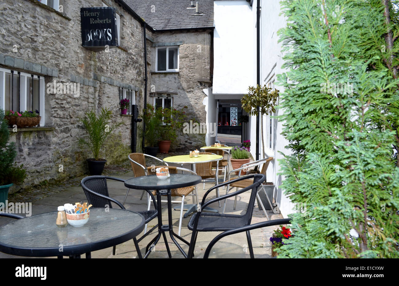 A stop off for a rest and brew in a lovely little courtyard in Kendal, Cumbria. - Stock Image