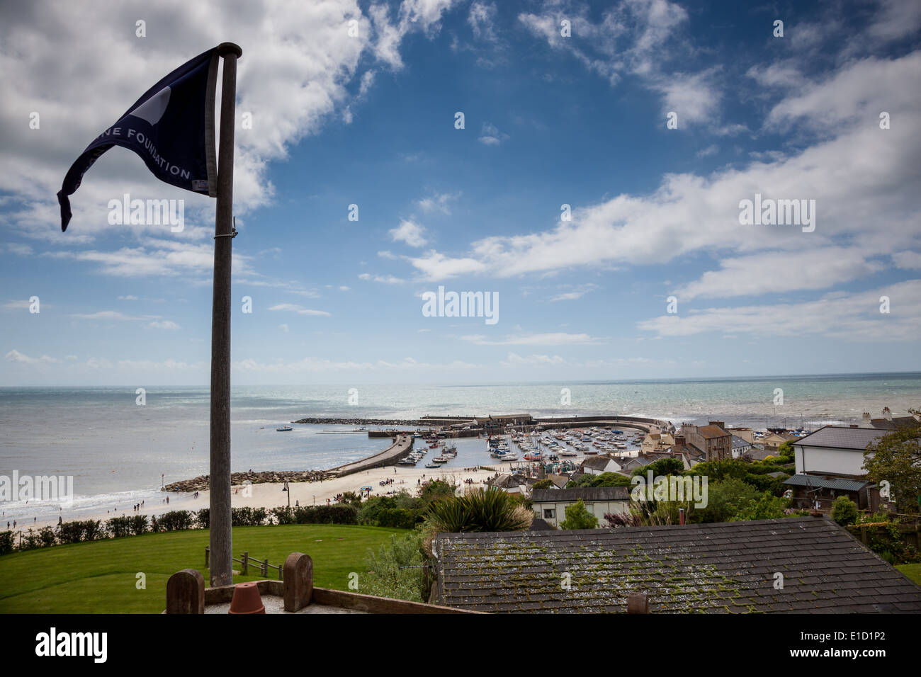 The view across The Cobb and Harbour from Hix's Oyster and Fish Bar, Lyme Regis, Dorset - Stock Image