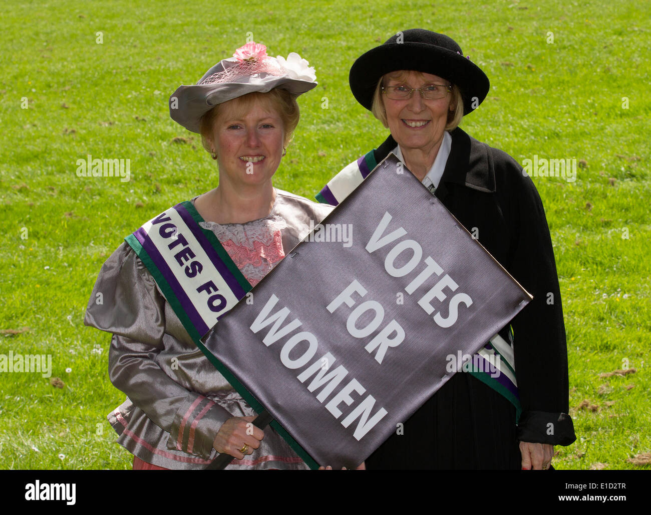 Votes for women suffrage, a woman seeking the right to vote through organized protest. Suffragettes fancy dress 1903 period outfits for adults with placards in Preston, UK 31st May, 2014.  Goosnargh & Whittingham Whitsuntide Festival.  This wonderful piece of English Heritage, which took place on a gloriously sunny Saturday,  is organised by the Festival Committee and a group of hugely dedicated friends in Goosnargh & Whittingham, close to the city of Preston in Lancashire, North West England. Stock Photo