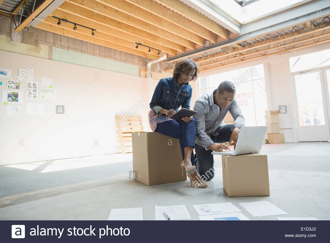 Business people working in new office - Stock Image