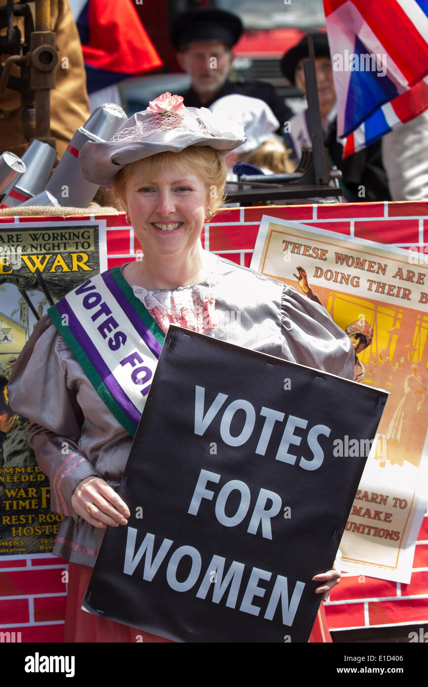 Votes for women suffrage, a woman seeking the right to vote through organized protest. Suffragettes fancy dress 1903 period hats, outfits for adults with placards in Preston, UK 31st May, 2014.  Goosnargh & Whittingham Whitsuntide Festival.  This wonderful piece of English Heritage, which took place on a gloriously sunny Saturday,  is organised by the Festival Committee and a group of hugely dedicated friends in Goosnargh & Whittingham, close to the city of Preston in Lancashire, North West England. - Stock Image