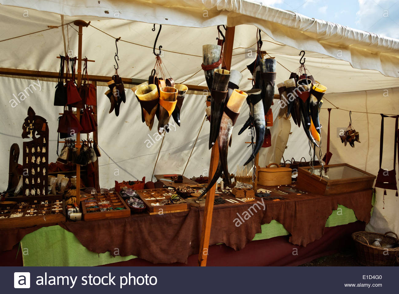 Leather, bone and horn souvenirs are on offer to tourists who visit the Viking market town of Haithabu in northern Germany. - Stock Image