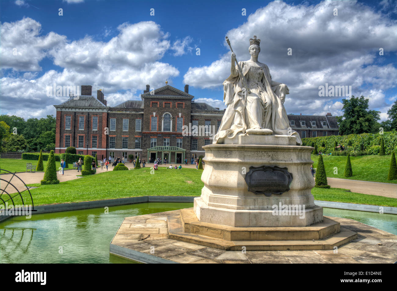 HDR image of A Statue of Queen Victoria outside of Kensington Palace a royal residence set in Kensington Gardens, Stock Photo